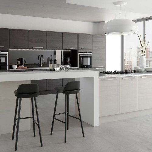 Light grey & black contemporary kitchen with pendant hood