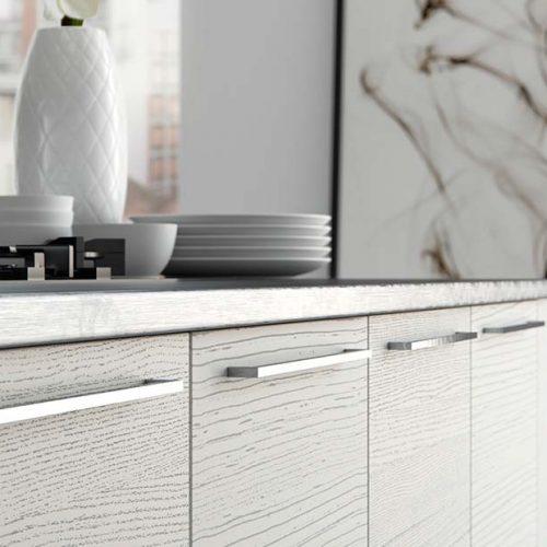 Light-grey-woodgrain-effect-kitchen-cabinets_chrome-bar-handles_modern_contemporary-UF