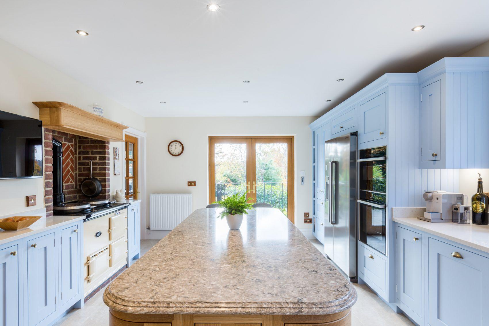 Blue shaker kitchen with granite work top