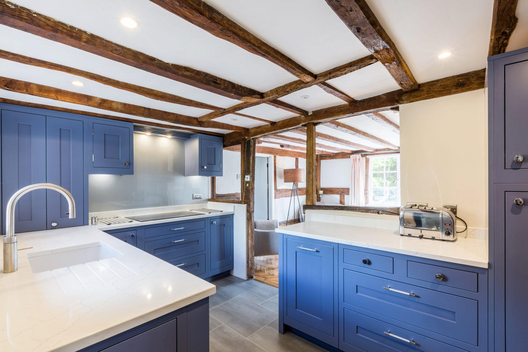 dark blue in frame shaker kitchen