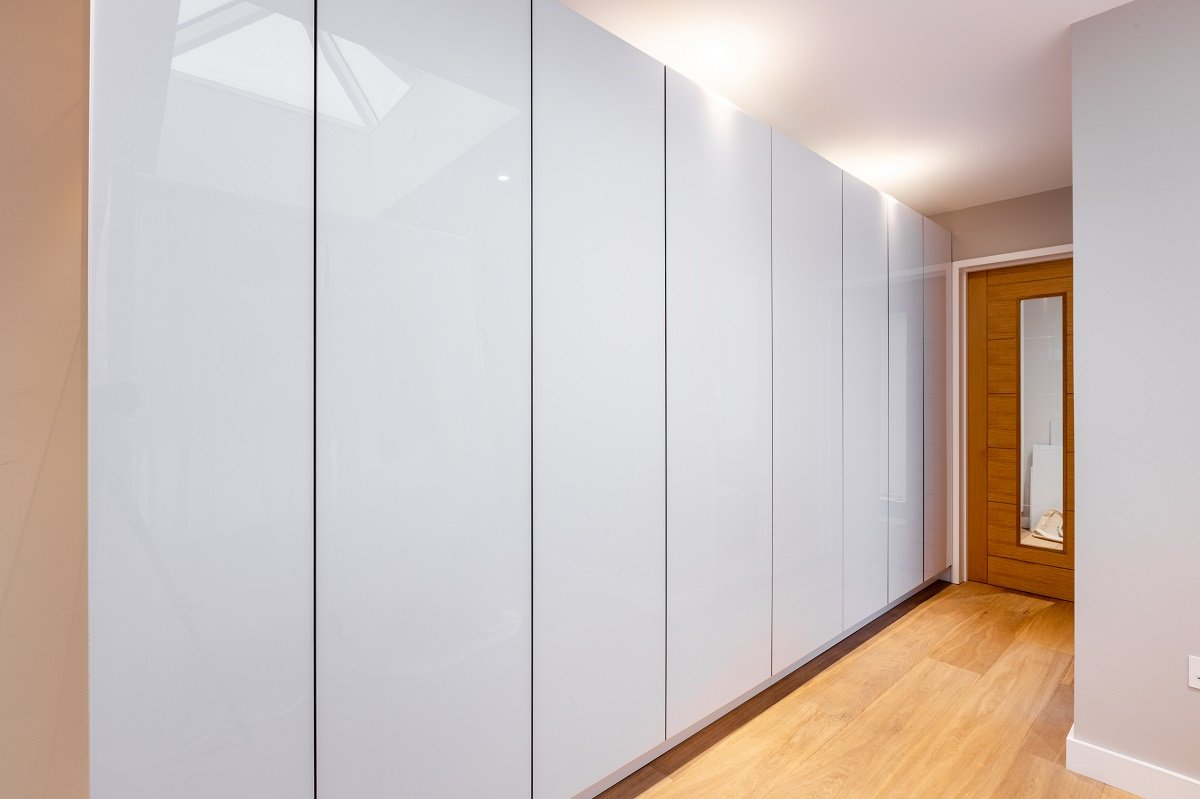 modern white gloss handleless fitted wardrobes