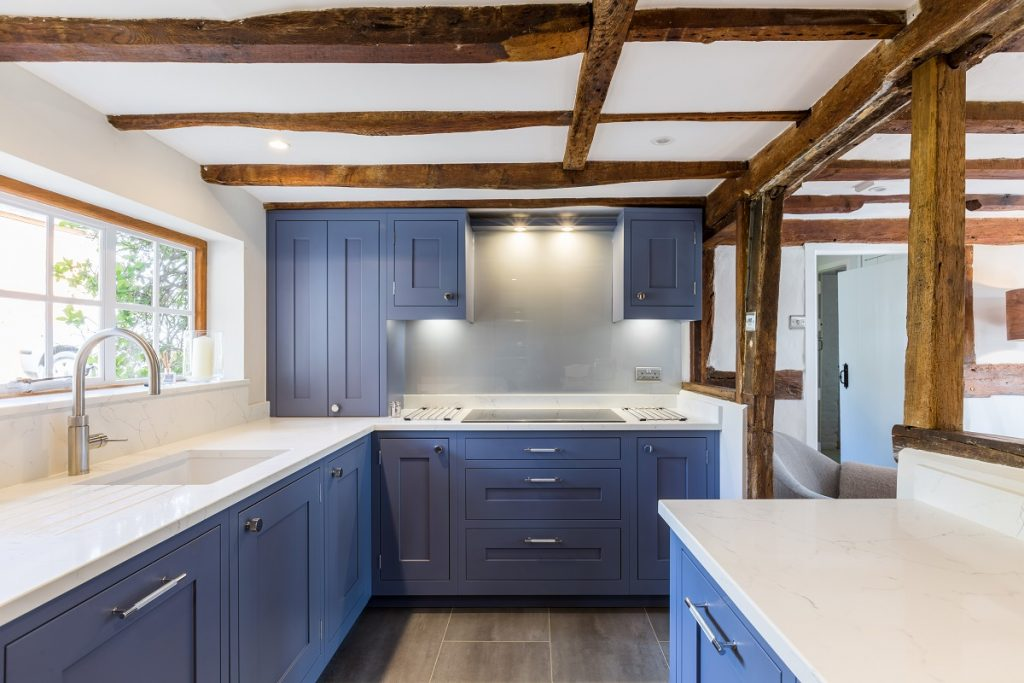 Blue shaker kitchen in a period cottage